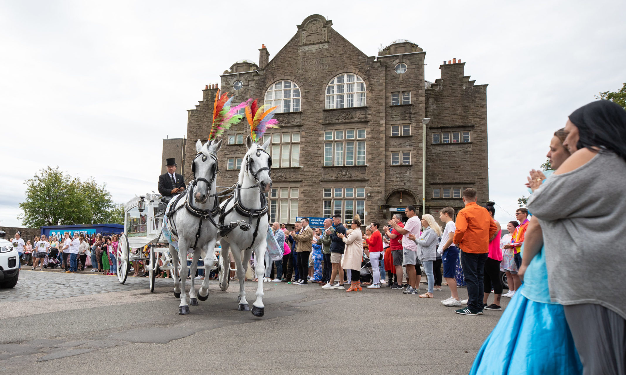 The horse-and-carriage pass Clepington Primary School.