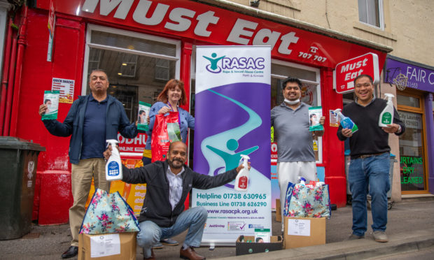 Perth Welfare Society and Must Eat staff handed the donations to RASAC PK boss Jen Stewart on Tuesday.