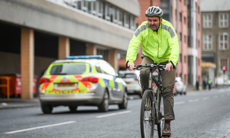 Tele News, Unknown story, CR0016674 . Plans for plain clothes officers to be out on bikes fining motorists for close passes on cyclists are in doubt. Pic shows; Richard Rooney cycling in traffic in Ward Road, Dundee. Thursday, 21st November, 2019. Kris Miller/DCT Media