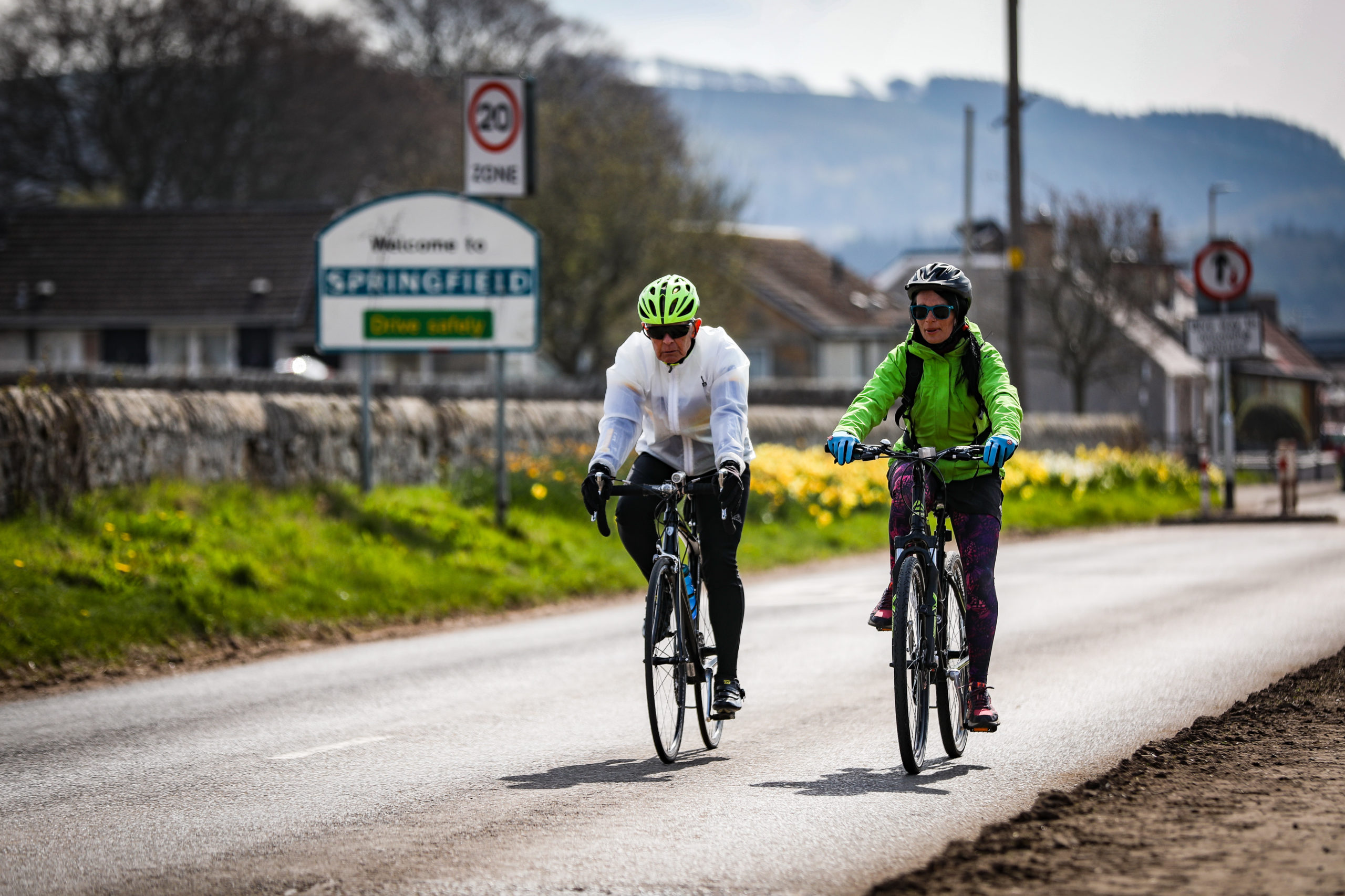 Courier Feats, Gayle Ritchie story, CR0008209 . 82 year old John McNally is the oldest entrance in the Etape cycle race and will be doing it for the 10th time this year. Gayle goes for a (18 mile) training cycle round Fife with John. Pic shows; John McNally and Gayle cycling in Fife. Monday, 15th April, 2019. Kris Miller/DC Thomson Media.