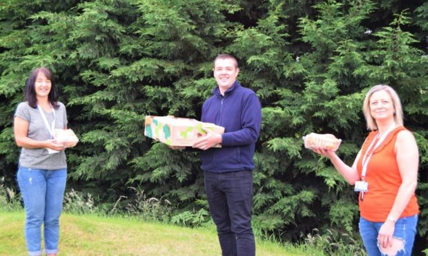 Kettle Produce makes stew pack donation to Fife Gingerbread. (L-R) Sandra Kennedy – Fife Gingerbread, Peter Strange – Development Production Manager, Kettle Produce and Zoe Taylor - Community and Inclusion Development Co-ordinator, Fife Gingerbread.