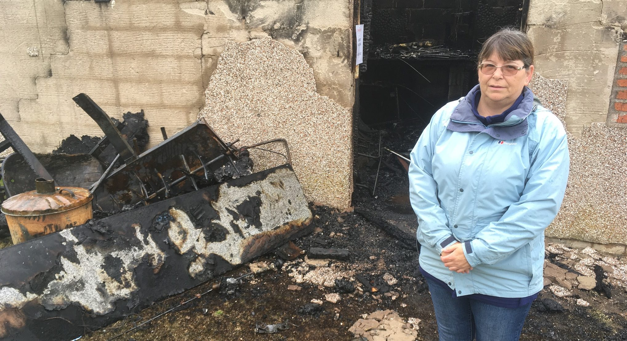 Susan Vines, a member of the club's management team with some of the fire damage.