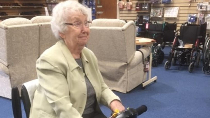 Marion Davis on her mobile scooter when the family bought it in 2017.