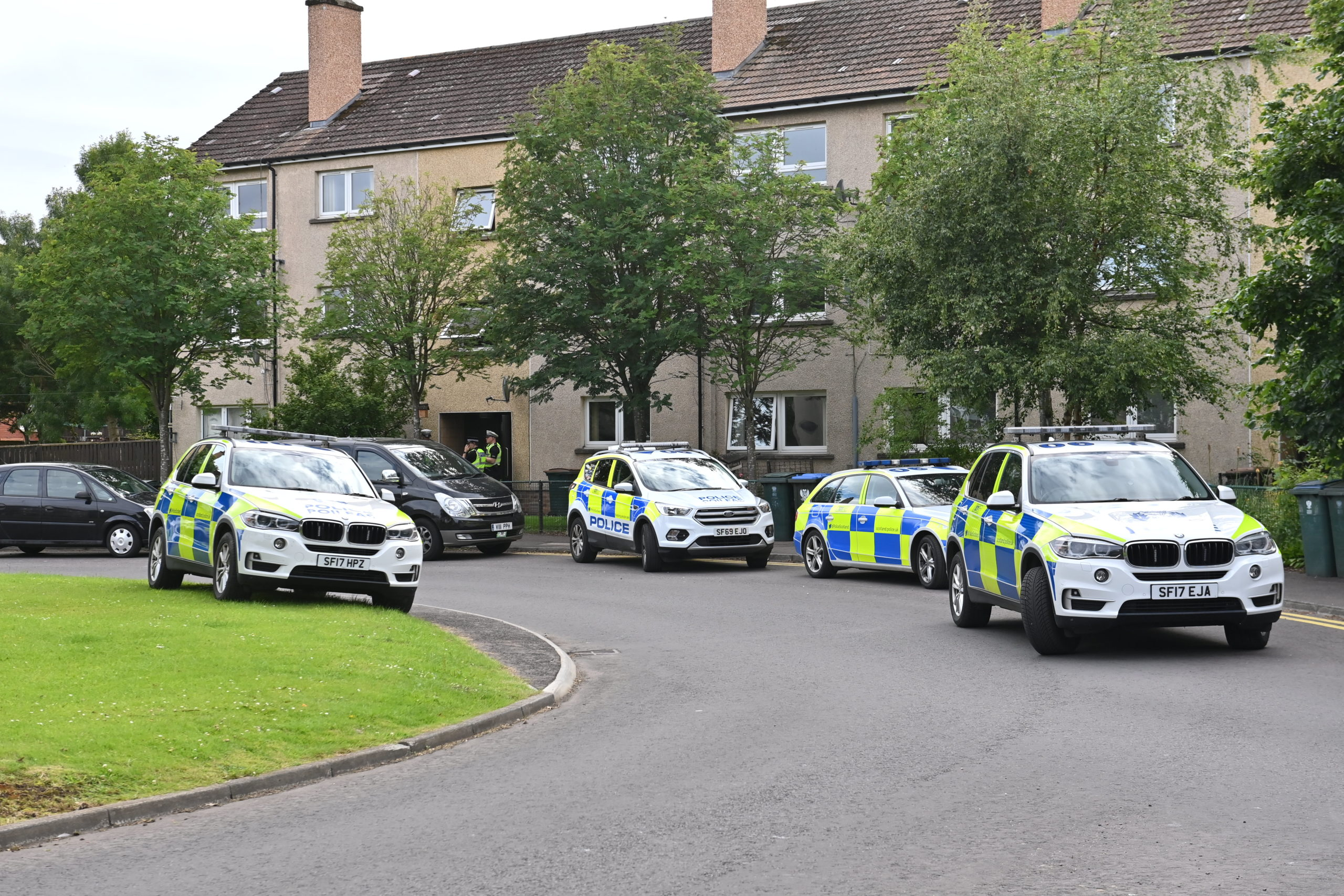 Police attend at Newhouse Road, Perth, on Saturday night.