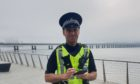 Tayside-based PC Garrie Watson using a mobile device