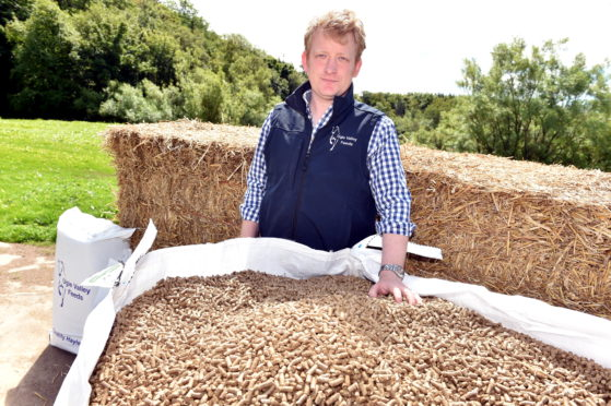 Ugie Valley Feed's Fraser Mackintosh at the machine that produces the pellets.