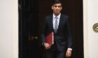 Chancellor of the Exchequer Rishi Sunak departs 11 Downing Street, in Westminster, London, to deliver a summer economic update at the Houses of Parliament in July 2020.