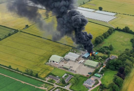 The fire at Rosemount Farm near Blairgowrie, sent plumes of thick black smoke into the sky.