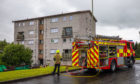 A fuse box fire at a block of flats on Strathtay Road was put out by firefighters.