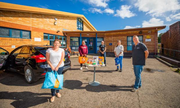PRI and Ninewells staff nurse Natalie Beattie handed over the donation to Letham4all team members Graham Holden, John Keith, Susan Matson and board member John Rebbeck.