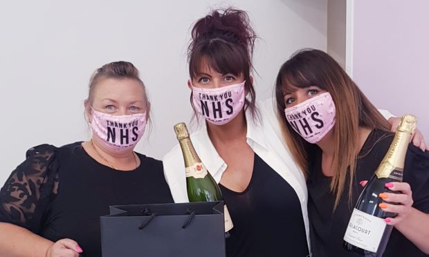 From left to right Susan Sangster, owner Marie McIntosh Ramminger and Nadine Torrie