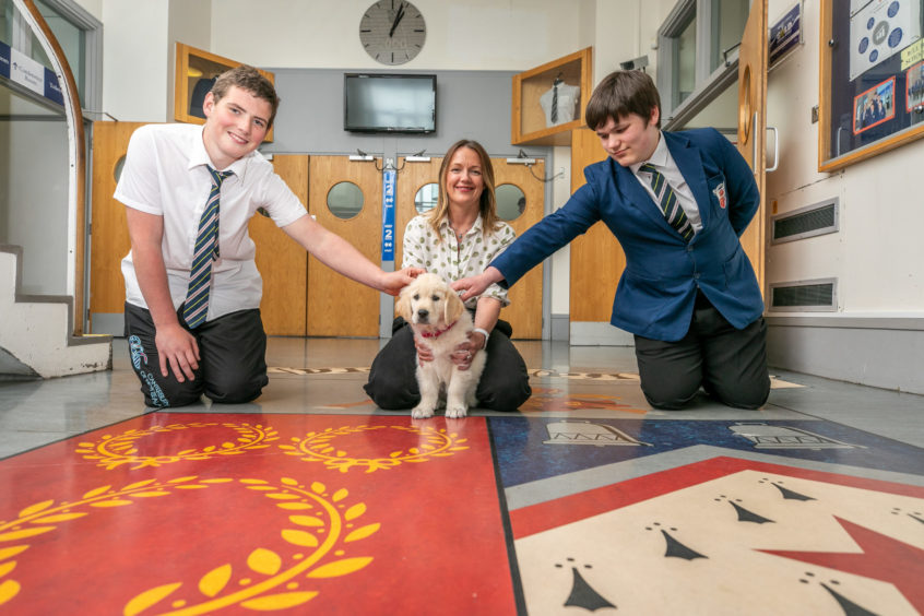 Pupils Logan Fenton and Callum Christie welcomed therapy dog Bella in July alongside headteacher Carol Ann Penrose.