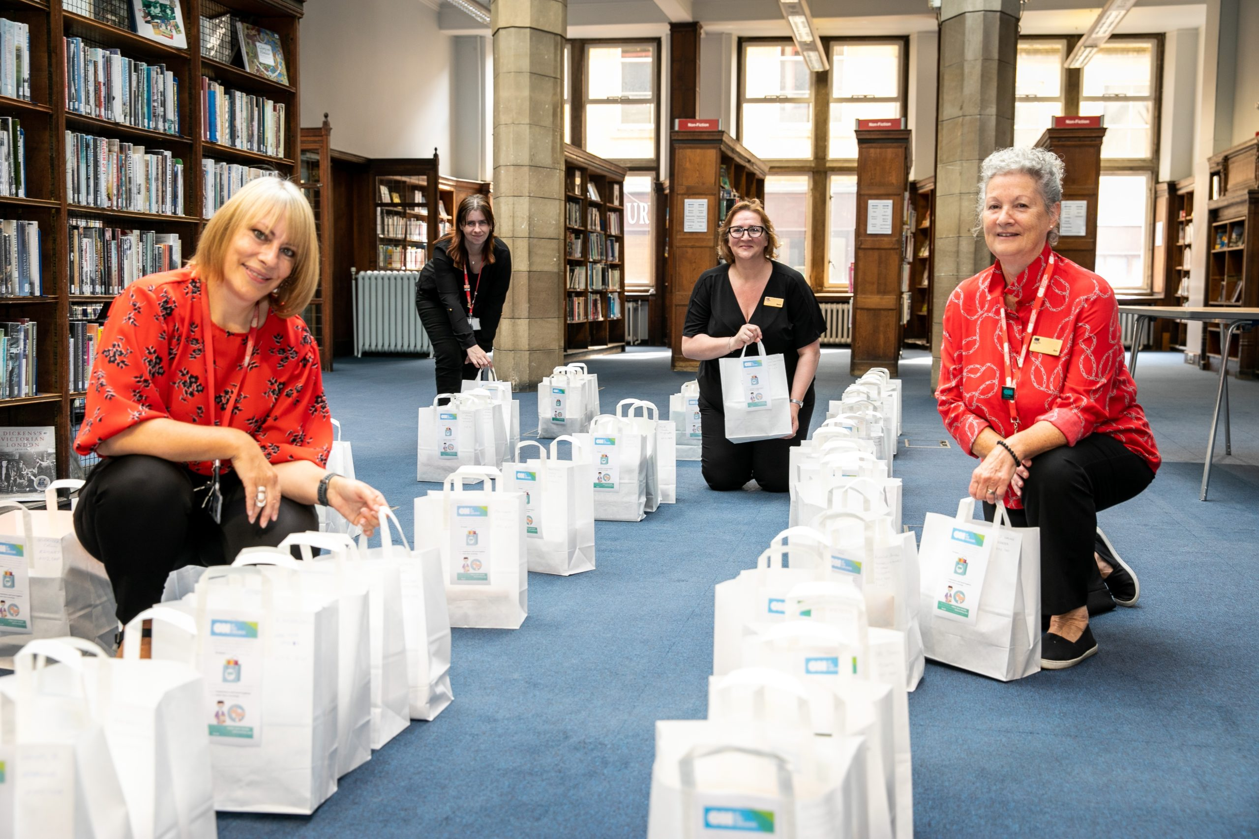 Jillian McFarlane, Sharon Brown, Donna Dewar and Ann McBurnie (Cultural Services Staff) with some of the bags for collection using the new Connect & Collect service at Dunfermline Carnegie Library and Galleries.