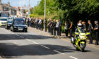 Police line Masterton Road as the funeral procession for Inspector Chris Mutter makes its way to Dunfermline Crematorium.