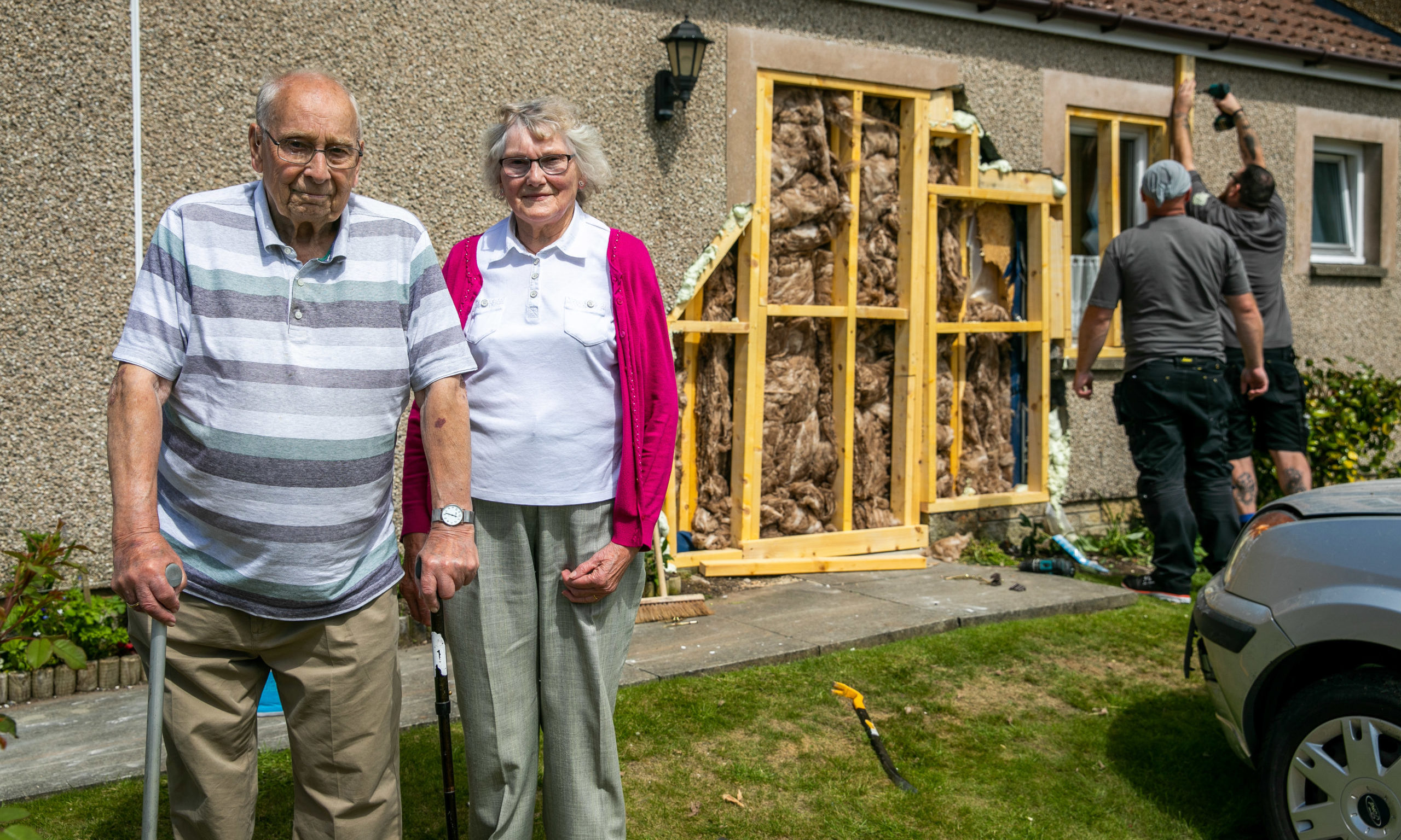 Mr and Mrs Pryde outside their damaged house.