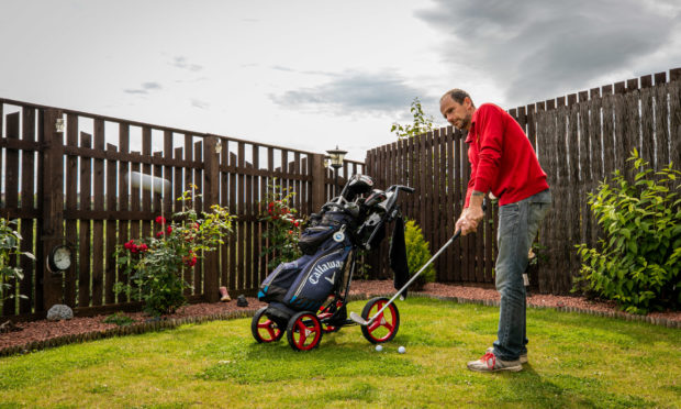 Robert getting into the swing in his back garden.