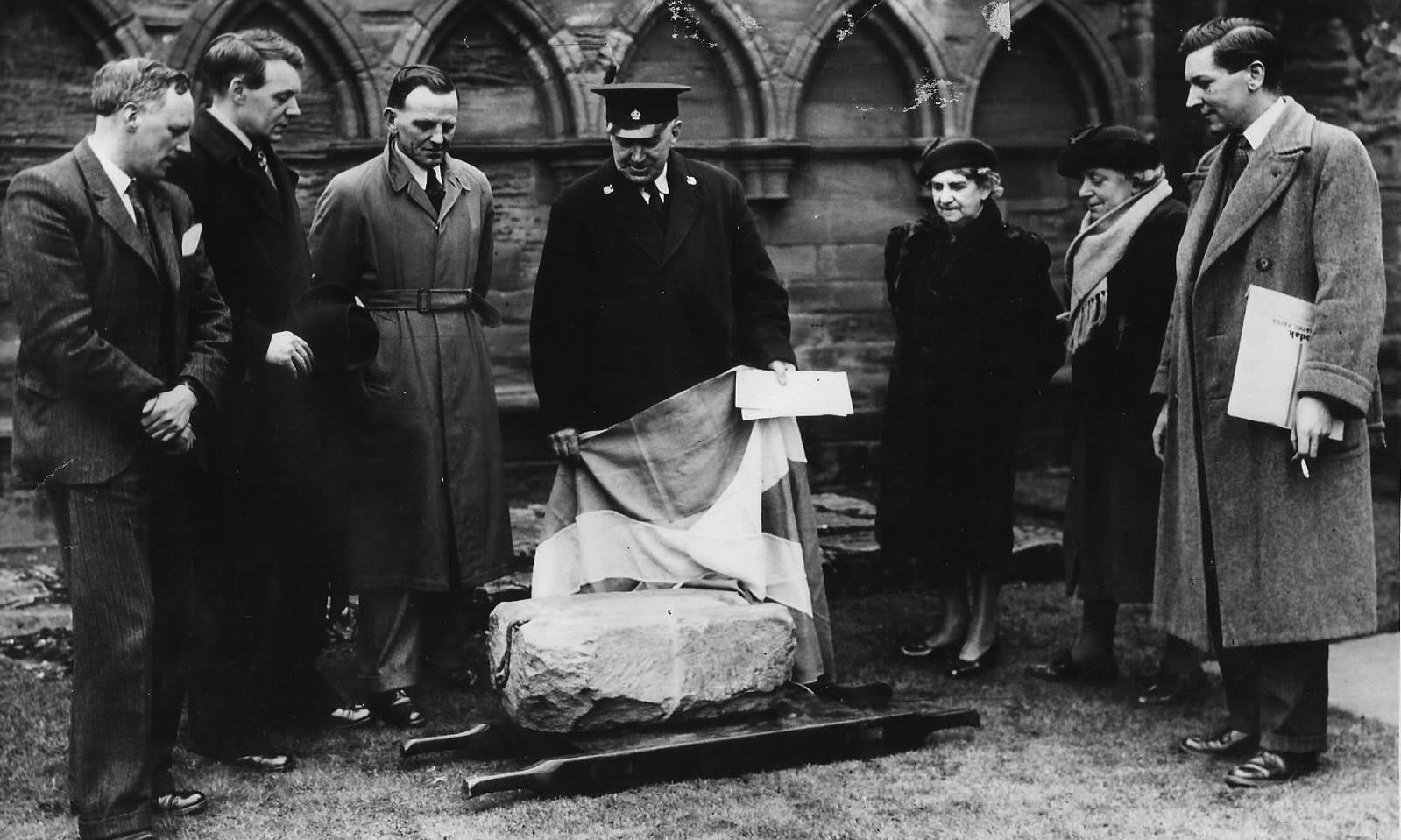 A group of local officials inspect the Stone of Destiny at Arbroath Abbey in 1951.