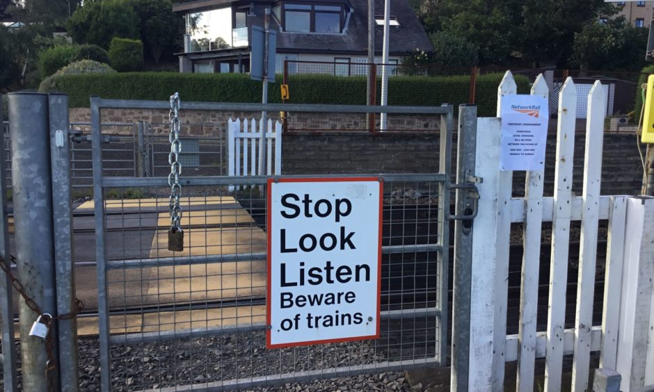 Dundee level crossing reopens to pedestrians but mystery surrounds its future - The Courier
