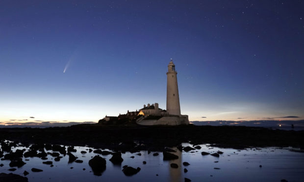 Comet Neowise passes St Mary's Lighthouse in Whitley Bay in the early hours of Tuesday morning. PA Photo. Picture date: Tuesday July 14, 2020. Photo credit should read: Owen Humphreys/PA Wire