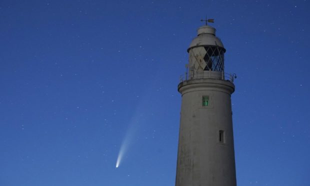 Comet Neowise passes St Mary's Lighthouse in Whitley Bay in the early hours of Tuesday morning.