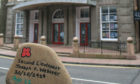 The painted stone has been placed at the Webster Memorial Theatre.