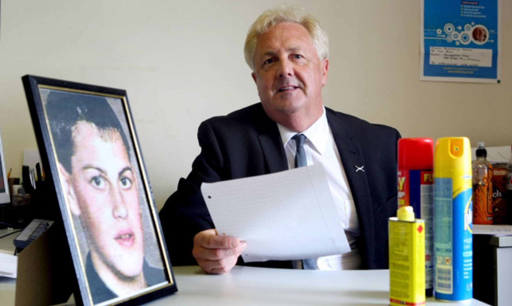 John O'Brien beside a picture of his son Lee.