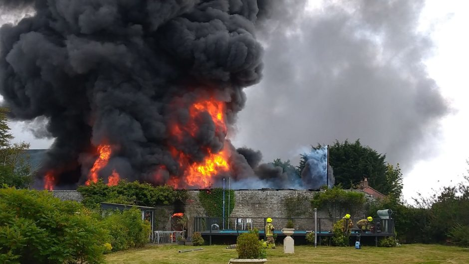 Fire crews were forced to use water from an outoor pool to battle the blaze