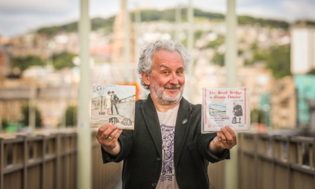 Shane Quentin with his records on the Tay Road Bridge.