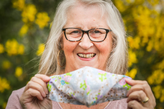 Glamis woman Julia Richards has raised £1000 for Whitehills Health and Community Care Centre by making masks for villagers. Picture shows; Julia Richards with some of her masks. Wednesday 8th July, 2020. Mhairi Edwards/DCT Media
