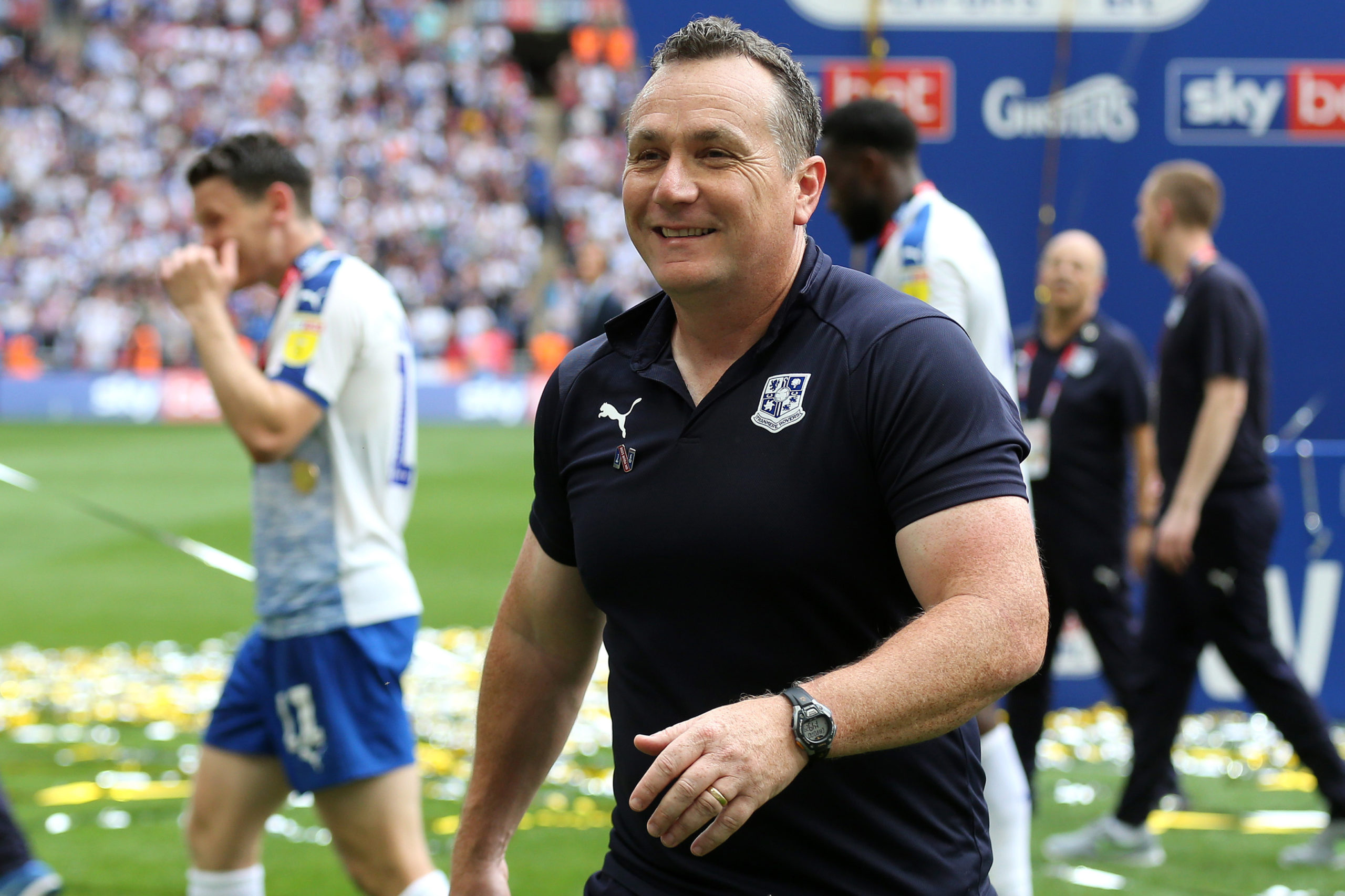 Micky Mellon celebrates play-off success.