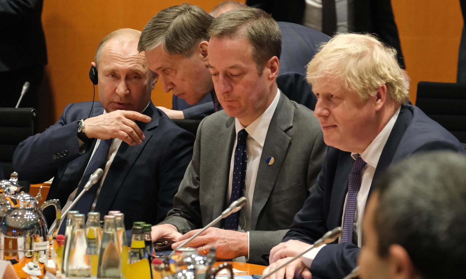 St Andrews University expert Professor Phil O'Brien says Russian President Vladimir Putin, left, sees weakening the Western alliance as being in his interest.