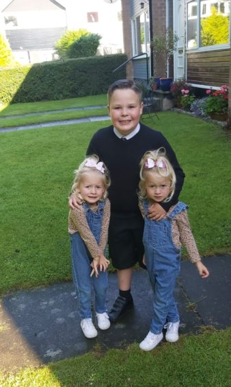 Josh going off to his first day in P5 at Mill of Mains and his sisters Willow and Lyla starting Mill of Mains nursery