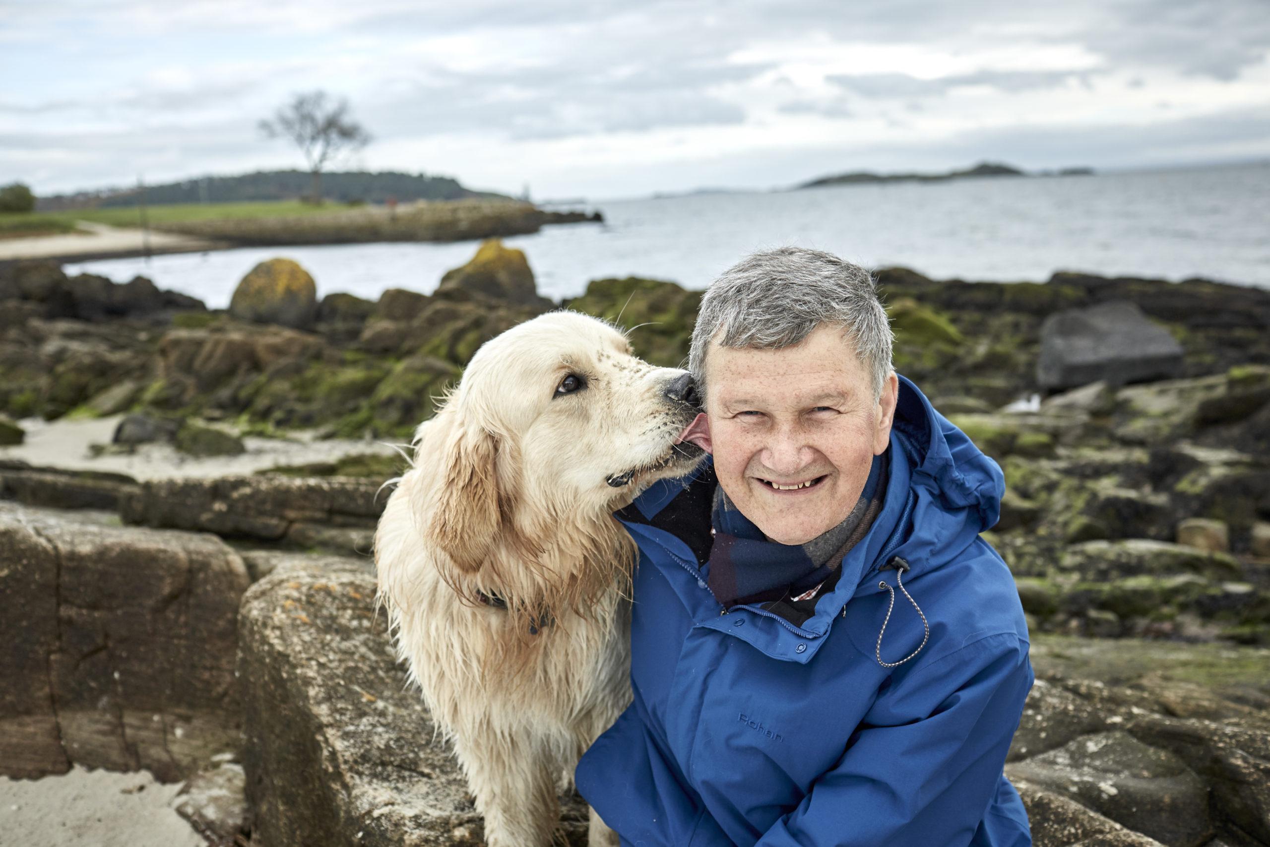 Rob Lester walking his dog,