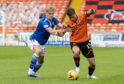 Saints' Ali McCann and United's Jamie Robson wrestle for the ball.