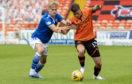 Jamie Robson, right, takes on St Johnstone player Ali McCann.