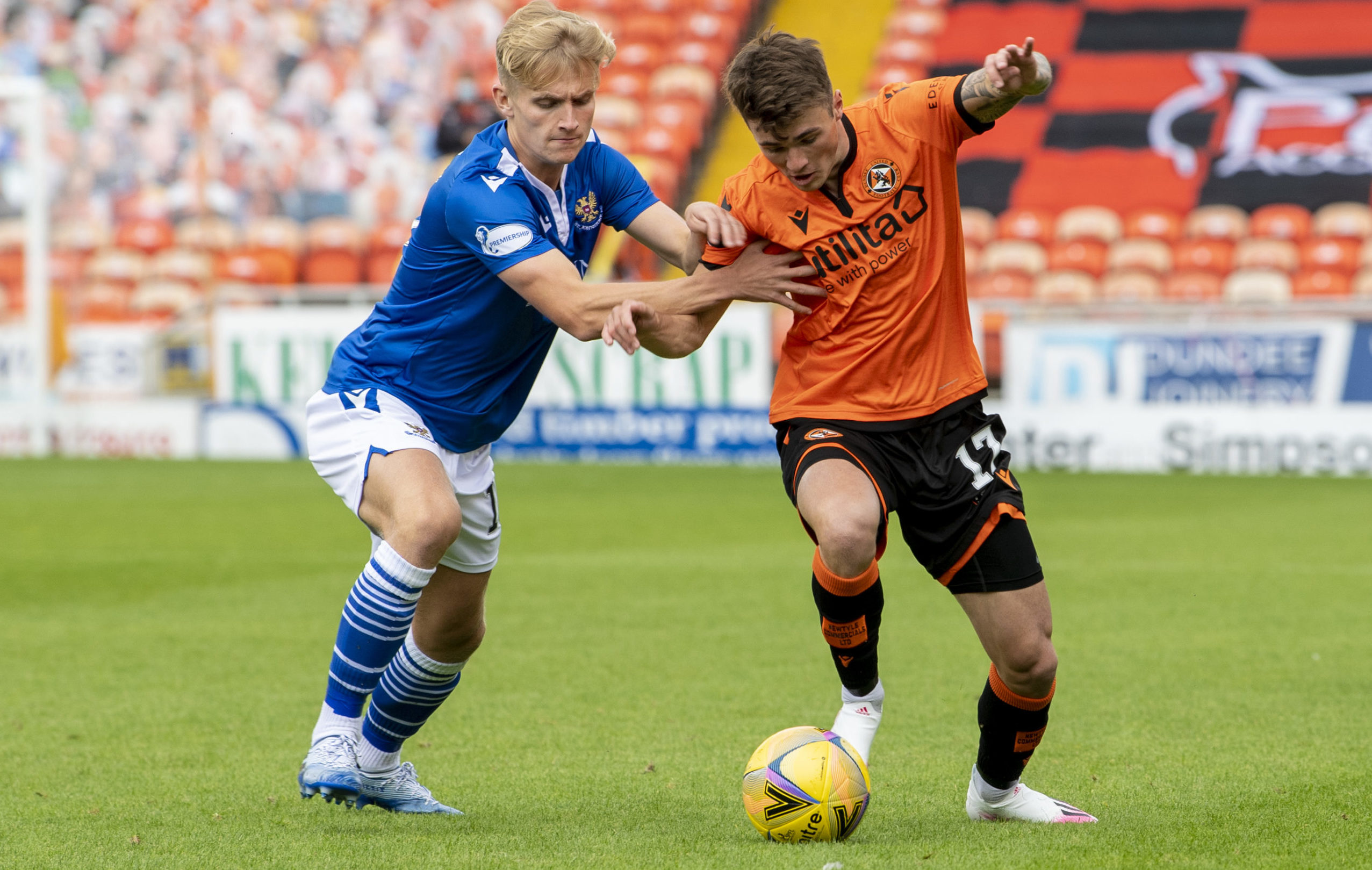 Jamie Robson, right, takes on St Johnstone player Ali McCann.