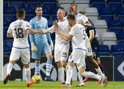 Kilmarnock's Chris Burke is mobbed after scoring against Ross County.