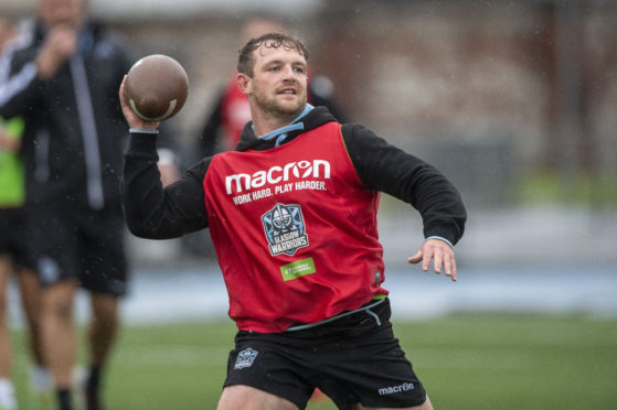 Nick Grigg trying a little American Football in training at Glasgow this week.