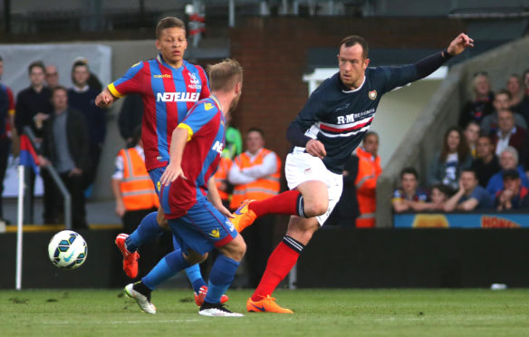 Charlie Adam in action in Julian Speroni's Crystal Palace testimonial in 2015.