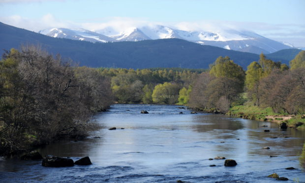 The River Spey with a snow Braeriach in the distance.