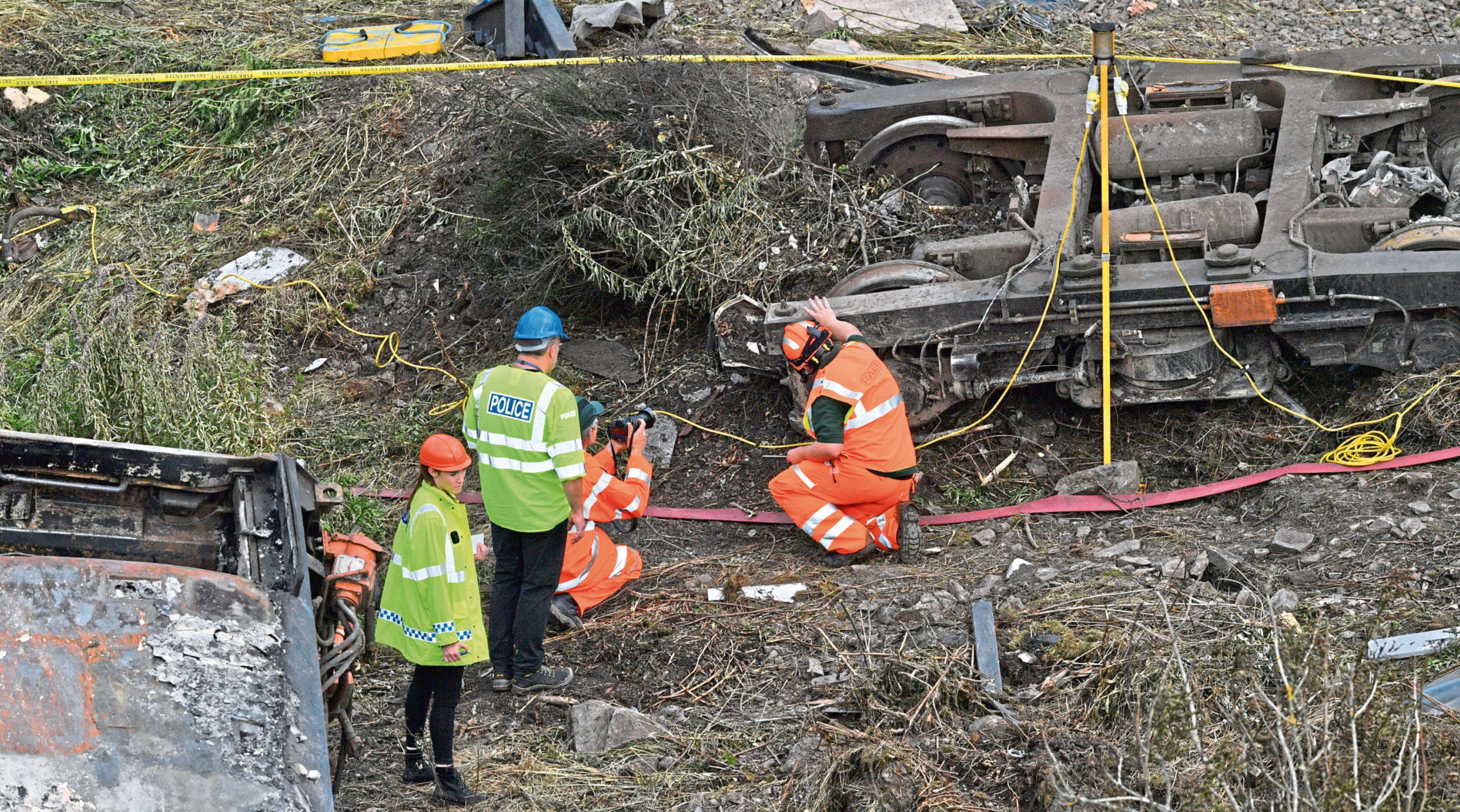 Emergency services inspect the scene near Stonehaven, Aberdeenshire, following the derailment of the ScotRail train which cost the lives of three people.