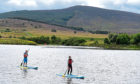 Gayle and Jason enjoying the stunning scenery around Knockburn Loch.