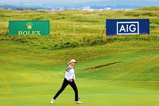Popov TROON, SCOTLAND - AUGUST 23: SophiaPopov of Germany celebrates after putting a birdie on the 15th green during Day Four of the 2020 AIG Women's Open at Royal Troon on August 23, 2020 in Troon, Scotland. (Photo by R&A - Handout/R&A via Getty Images)