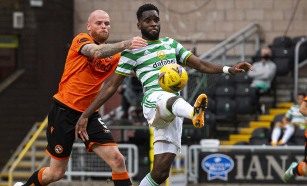 Mark Connolly tussles with Celtic striker Odsonne Edouard.