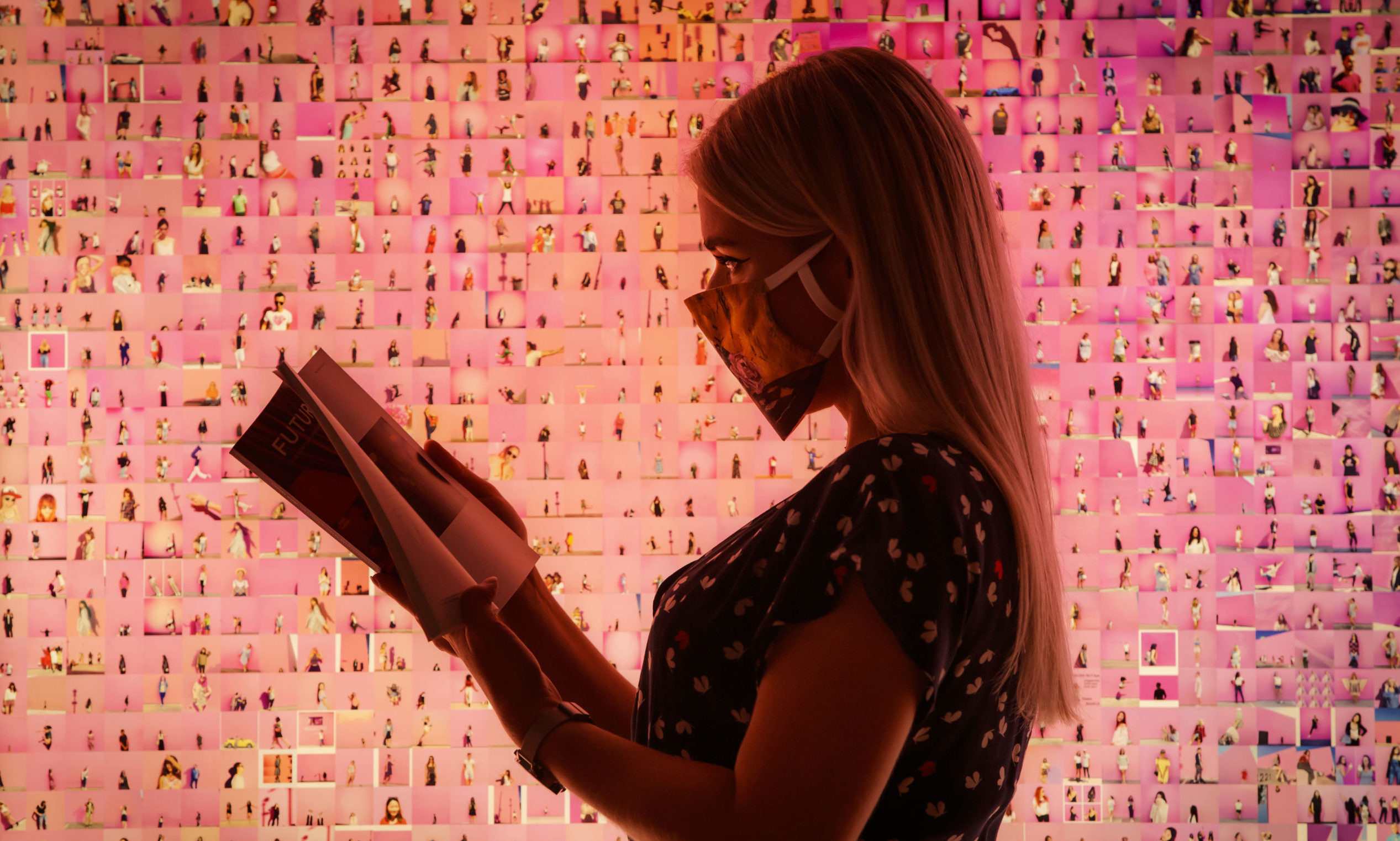 A visitor reads a program in front of a work titled 'Murmurations #23: 10,000 selfies (with a pink wall in Los Angeles)' by artist Stephanie Potter Corwin, that forms part of the Aesthetica Art Prize exhibition on show at York Art Gallery in Yorkshire. PA Photo. Picture date: Thursday August 13, 2020. Following reopening the exhibition is free to visit, with the gallery hoping that by removing admission charges there will be a higher number and increased diversity of visitors. The Aesthetica Art Prize is a celebration of contemporary art. The annual prize, now in its 13th year, provides a platform for both established and emerging practitioners from across the world.Photo credit should read: Danny Lawson/PA Wire