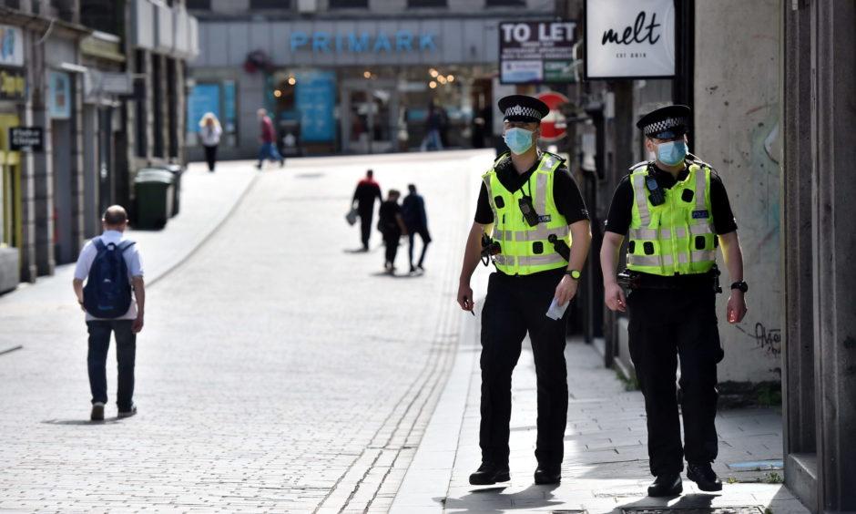 Police officers patrol Union Street and Belmont Street in Aberdeen.