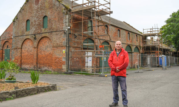Feat chairman Brian Robertson at the flax mill.