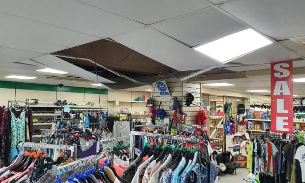 The thieves entered the premises through the roof, causing the ceiling to collapse.