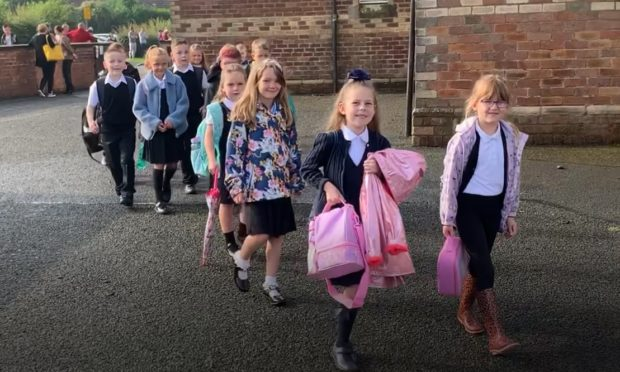 Coaltown of Balgonie Primary School pupils looked delighted to return on their first day back at school.