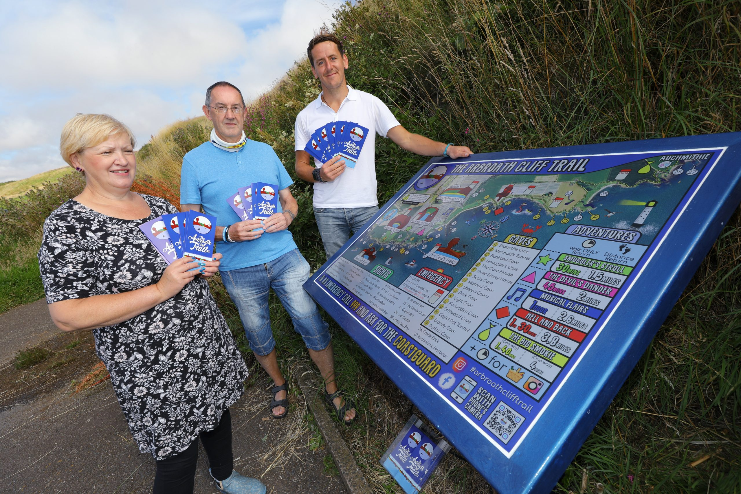 Councillor Brenda Durno, Arbroath community councillor Graham Smith and Cameron Smith at the new information board.